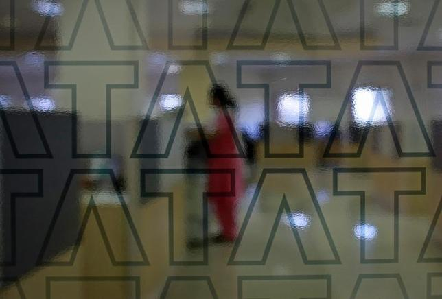 An employee of Tata Consultancy Services (TCS) works inside the company headquarters in Mumbai March 14, 2013. REUTERS/Danish Siddiqui