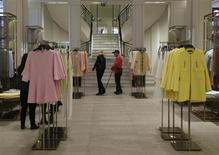 People walk inside a Zara store in central Madrid March 18, 2014. Inditex, the world's biggest fashion retailer, will accelerate investment in 2014 to open more new stores after results last year were hit by falling currencies outside the euro zone and the cost of revamping flagship stores. REUTERS/Andrea Comas