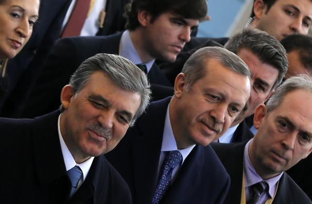 Turkish President Abdullah Gul (L) and Prime Minister Tayyip Erdogan arrive at an opening ceremony of a new line of the Ankara Metro in Ankara February 12, 2014. REUTERS/Umit Bektas