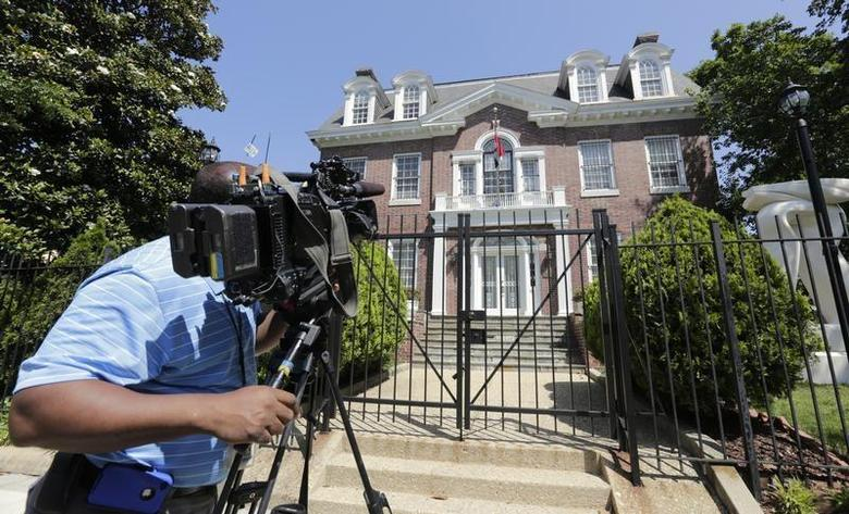A news cameraman films the Syrian Embassy in Washington May 29, 2012. REUTERS/Kevin Lamarque
