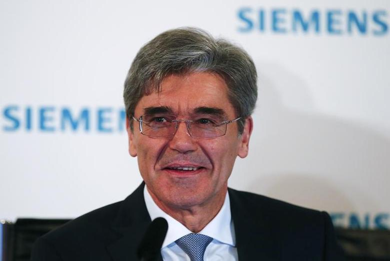 Joe Kaeser, Chief Executive Officer of German engineering group Siemens, addresses a news conference ahead of the company's annual shareholders meeting in Munich January 28, 2014. REUTERS/Michael Dalder