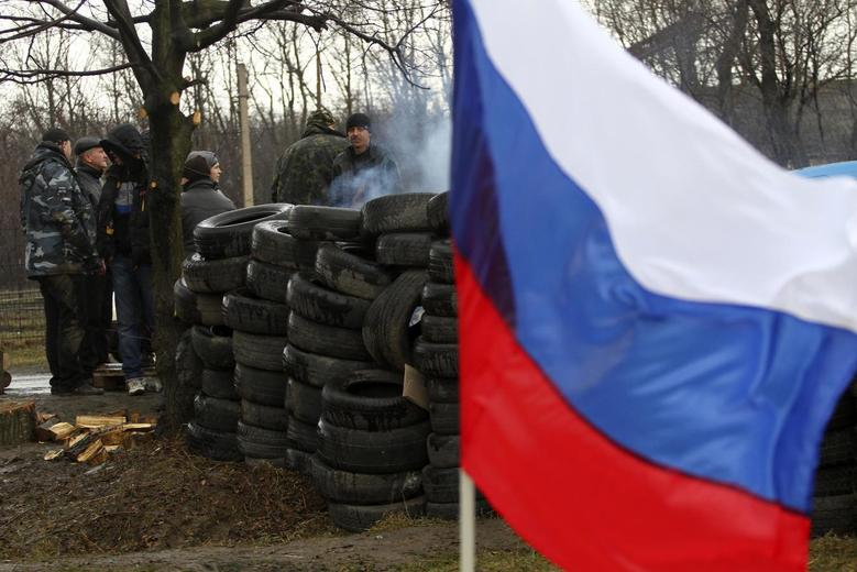Members of a pro-Russian self-defence unit gather at a check point in Gorlovka in the Donetsk region, March 19, 2014. REUTERS/Stringer