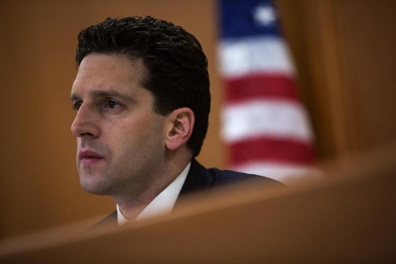 State financial regulator Benjamin Lawsky listens to testimony at a hearing in New York January 29, 2014. REUTERS/Eric Thayer
