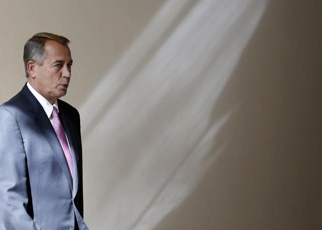 U.S. Speaker of the House John Boehner walks to his weekly news conference on Capitol Hill in Washington, February 6, 2014. REUTERS/Larry Downing