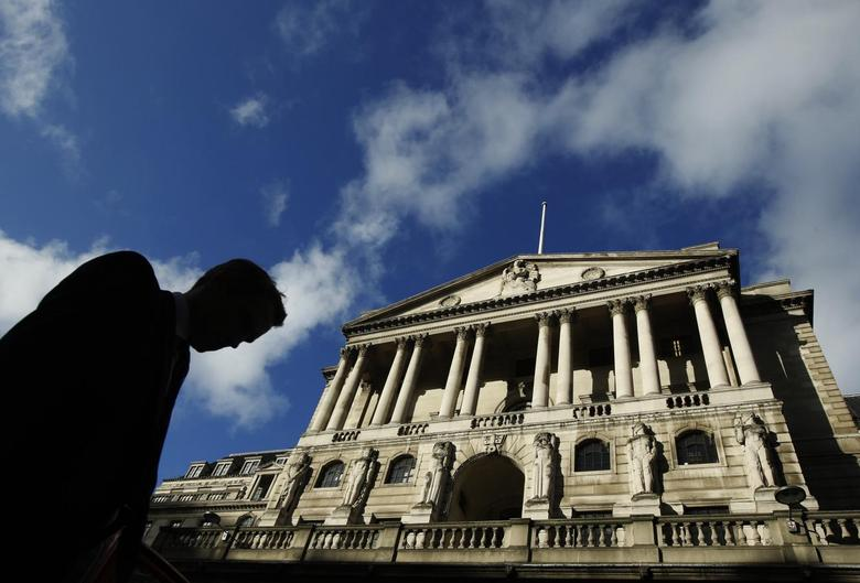 A man passes the Bank of England in London January 16, 2014. REUTERS/Luke MacGregor