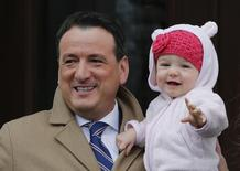 Greg Rickford leaves with his daughter Abigail after being sworn in as Canada's new Natural Resources Minister at Rideau Hall in Ottawa March 19, 2014. REUTERS/Chris Wattie