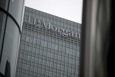 A sign is seen on the Canary Wharf offices of JP Morgan in London September 19, 2013. REUTERS/Neil Hall