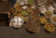 Bitcoins created by enthusiast Mike Caldwell are seen in a photo illustration at his office in Sandy, Utah, September 17, 2013. REUTERS/Jim Urquhart