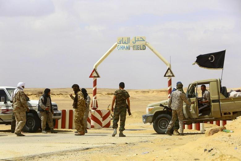 Rebels under Libyan rebel leader Ibrahim Jathran guard the entrance of the al-Ghani oil field, which is currently under the group's control, south of Ras Lanuf March 18, 2014. REUTERS/Stringer
