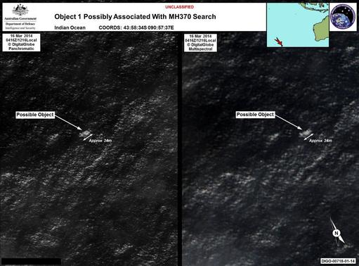 Satellite imagery provided to Australian Maritime Safety Authority (AMSA) of objects that may be possible debris of the missing Malaysia Airlines Flight MH370 in a revised area 185 km (115 miles) to the south east of the original search area in this picture released by AMSA March 20, 2014. A Search aircraft are investigating two objects floating in the southern Indian Ocean off Australia that could be debris from a Malaysian jetliner missing for 12 days with 239 people on board, officials said on Thursday. REUTERS-Australian Maritime Safety Authority-Handout via REUTERS