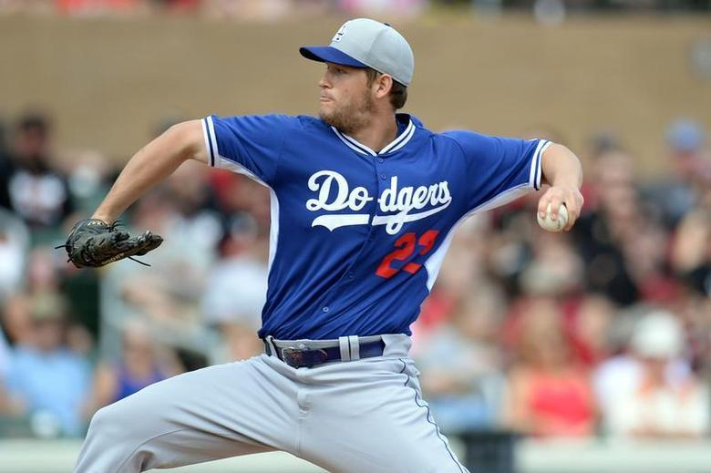 Feb 26, 2014; Salt River Pima-Maricopa, AZ, USA; Los Angeles Dodgers starting pitcher Clayton Kershaw (22) throws a pitch against the Arizona Diamondbacks during the first inning at Salt River Fields at Talking Stick. Mandatory Credit: Joe Camporeale-USA TODAY Sports - RTR3FR76