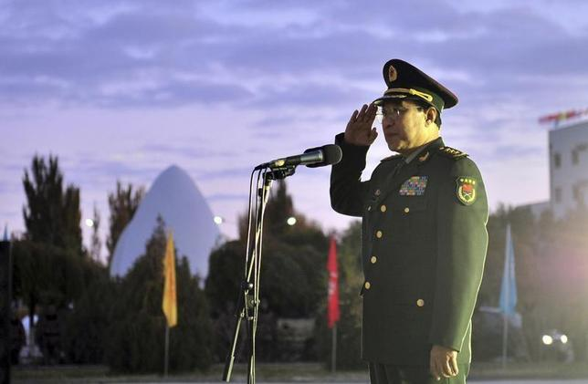 Vice Chairman of China's Central Military Commission General Xu Caihou salutes during his speech greeting the launch of China's unmanned spacecraft Shenzhou 8 at the Jiuquan Satellite Launch Centre in Gansu Province, November 1, 2011. REUTERS/China Daily