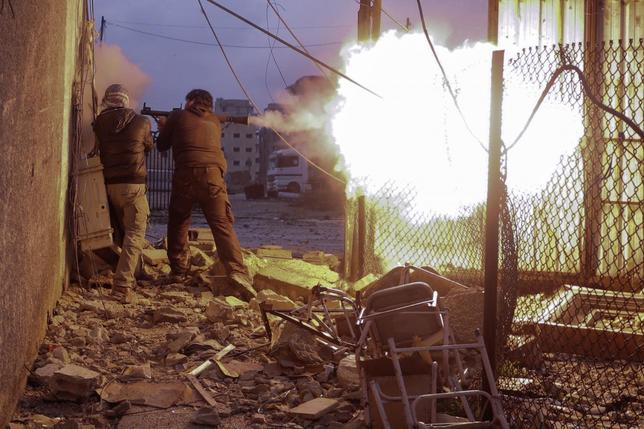 Syrian rebels fire a rocket-propelled grenade (RPG) towards a government controlled army checkpoint in the Ain Tarma neighborhood of Damascus on January 30, 2013. REUTERS/Goran Tomasevic