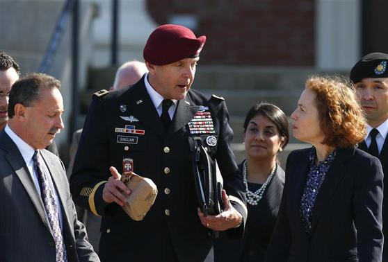 U.S. Army Brigadier General Jeffrey Sinclair leaves the courthouse after sentencing in his court-martial case at Fort Bragg in Fayetteville, North Carolina March 20, 2014. REUTERS-Chris Keane