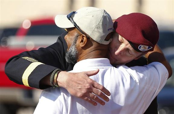 U.S. Army Brigadier General Jeffrey Sinclair shares a hug with his friend, retired command sergeant major Ian Toney after leaving the courthouse following sentencing in his court-martial case at Fort Bragg in Fayetteville, North Carolina March 20, 2014. REUTERS-Chris Keane