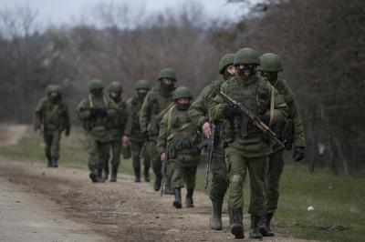 Obama hits closest Putin allies with sanctions over...