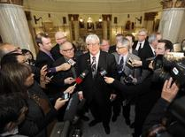 Alberta Deputy Premier Dave Hancock (C) announces his appointment as interim Premier following his party's caucus meeting in the Alberta Legislature in Edmonton March 20, 2014. REUTERS/Dan Riedlhuber