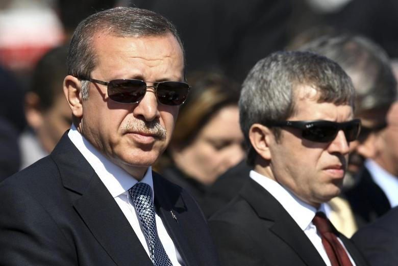 Turkish Prime Minister Tayyip Erdogan (L) attends a ceremony marking the 99th anniversary of the end of the Gallipoli campaign in Gallipoli, March 18, 2014, as he is flanked by officials. REUTERS/Stringer