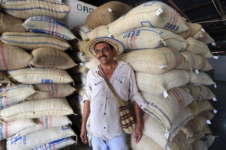 Coffee grower Ramon Eliodoro Mejia poses after selling 613 kg (1351 pounds) of organic coffee during the weighing and sale process at a warehouse of the National Coffee Growers Federation in Pueblo Bello, northern Cesar province January 29, 2014. REUTERS/Jose Miguel Gomez