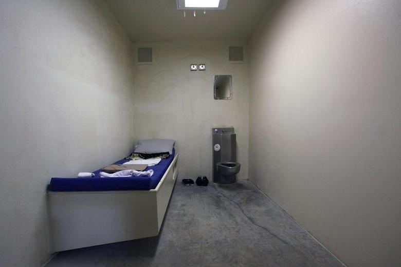 The interior of an unoccupied cell showing standard issue clothing given to prisoners is seen at Camp VI, a prison used to house detainees at the U.S. Naval Base at Guantanamo Bay March 5, 2013. REUTERS/Bob Strong