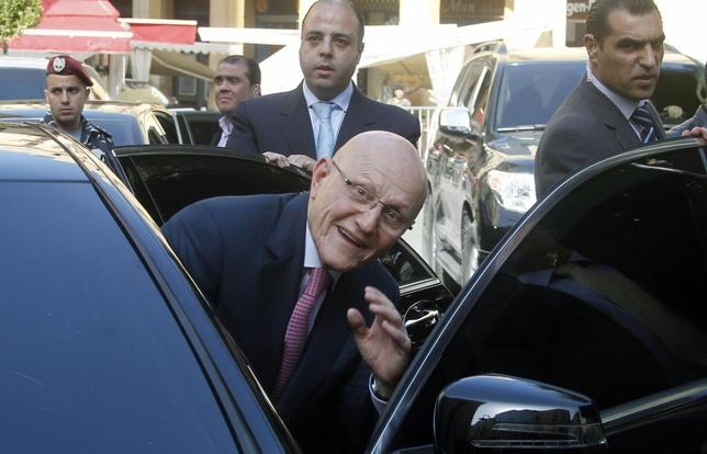 Lebanon's Prime Minister Tammam Salam smiles as he leaves the parliament in Beirut March 20, 2013. REUTERS/Sharif Karim