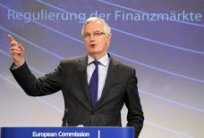 European Commissioner for Internal Market and Services Michel Barnier holds a news conference on the restructuring of the bank at the European Commission headquarters in Brussels January 29, 2014. REUTERS/Laurent Dubrule