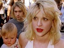 Kurt Cobain arrives with wife Courtney Love, holding their daughter Frances Bean Cobain, for the MTV Music Awards show in Los Angeles in this September 9 1992, file photo. REUTERS/Fred Prouser/Files