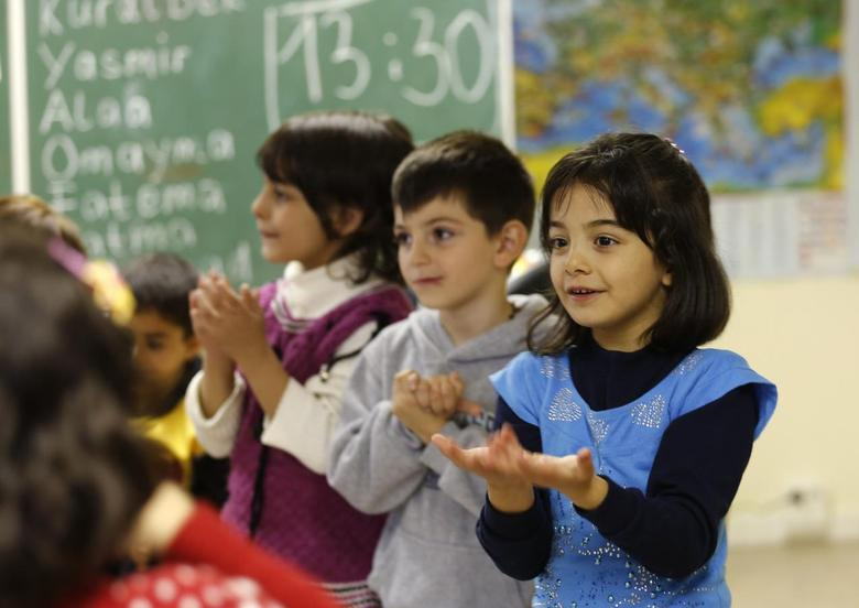 Syrian refugee children learn the German language in a school at the 'Friedland' refugee camp in the central German village of Friedland September 16, 2013. REUTERS/Ina Fassbender