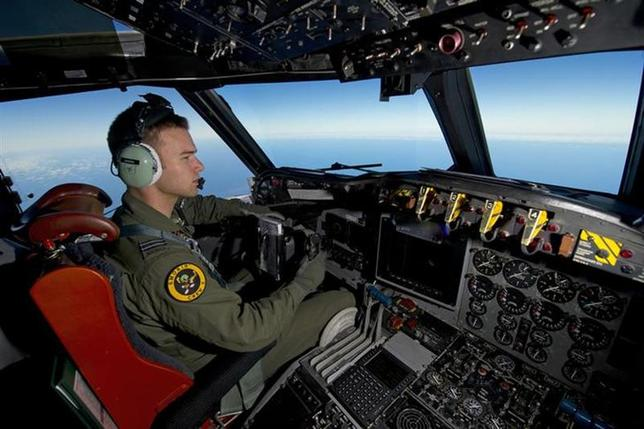 Royal Australian Air Force (RAAF) pilot, Flight Lieutenant Russell Adams from 10 Squadron, steers his AP-3C Orion over the Southern Indian Ocean during the search for missing Malaysian Airlines flight MH370 in this picture released by the Australian Defence Force March 20, 2014. REUTERS/Australian Defence Force/handout