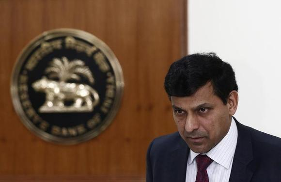 Reserve Bank of India (RBI) Governor Raghuram Rajan attends a joint news conference with India's Finance Minister Palaniappan Chidambaram (not pictured) in New Delhi March 7, 2014. REUTERS/Adnan Abidi/Files