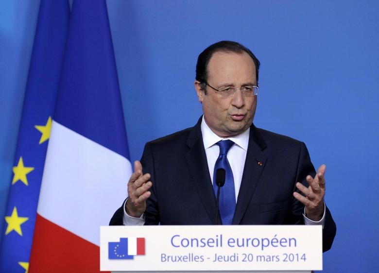 France's President Francois Hollande holds a news conference at a European Union leaders summit in Brussels March 21, 2014. REUTERS/Laurent Dubrule