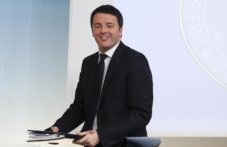 Italy's Prime Minister Matteo Renzi smiles as he arrives to lead a news conference at Chigi palace in Rome March 12, 2014 file photo. REUTERS/Remo Casilli