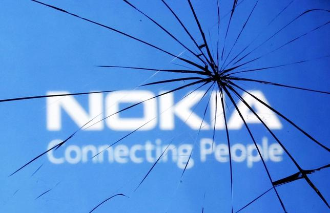 An illustration picture shows Nokia logo through a broken glass in the central Bosnian town of Zenica January 23, 2014. REUTERS/Dado Ruvic
