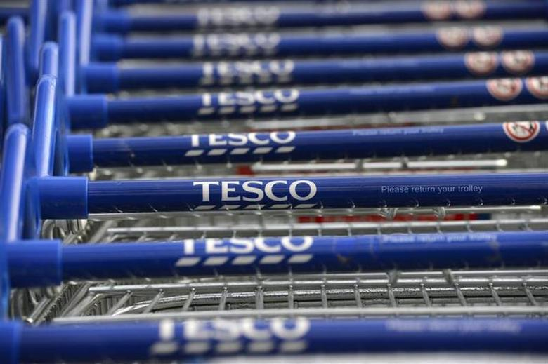 Trolleys are stacked outside a Tesco store in Hammersmith, west London October 3, 2012. REUTERS/Paul Hackett/Files