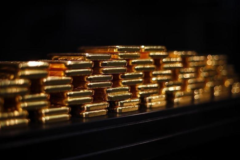 Gold bars are stacked at a safe deposit room of the ProAurum gold house in Munich March 6, 2014. REUTERS/Michael Dalder