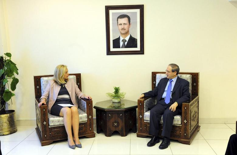 Syria's Deputy Foreign Minister Faisal al-Miqdad (R) meets Sigrid Kaag, Special Coordinator of the Organisation for the Prohibition of Chemical Weapons-United Nations (OPCW-UN) joint mission on eliminating Syria's chemical weapons programme, in Damascus March 16, 2014, in this handout released by Syria's national news agency SANA. REUTERS/SANA/Handout via Reuters