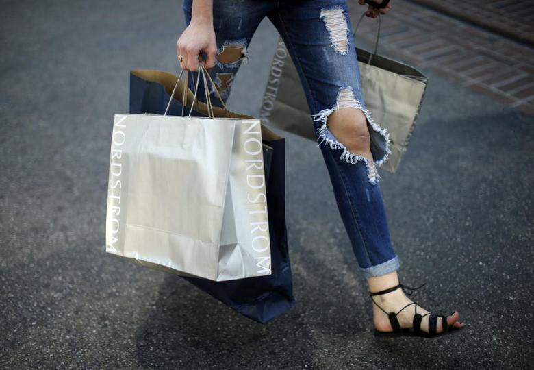 A woman carries Nordstrom shopping bags at The Grove mall in Los Angeles November 26, 2013. REUTERS/Lucy Nicholson