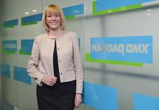 CEO Charlotte Crosswell of NASDAQ OMX NLX poses after an interview with Reuters in London March 20, 2014. REUTERS/Luke MacGregor