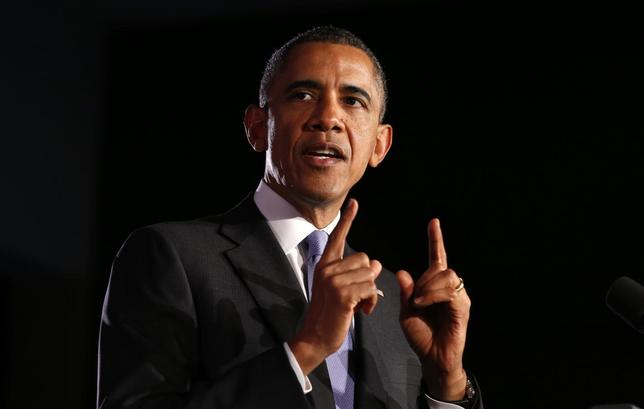 U.S. President Barack Obama speaks about expanding economic opportunity for women and working families, during a visit to Valencia College in Orlando, Florida, March 20, 2014. REUTERS/Kevin Lamarque