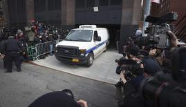 A New York City Medical Examiner van leaves the apartment building of designer L'Wren Scott in the Manhattan borough of New York March 17, 2014. REUTERS/Carlo Allegri