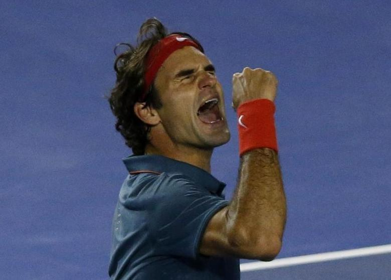 Roger Federer of Switzerland celebrates defeating Andy Murray of Britain in their men's singles quarter-final tennis match at the Australian Open 2014 tennis tournament in Melbourne January 22, 2014. REUTERS/Jason Reed
