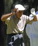 Jack Fleck, 89, winner of the 1955 U.S. Open, celebrates as he finishes on the ninth hole during the Par-3 tournament ahead of the 2011 Masters golf tournament at the Augusta National Golf Club in Augusta, Georgia, April 6, 2011. REUTERS/Mike Segar