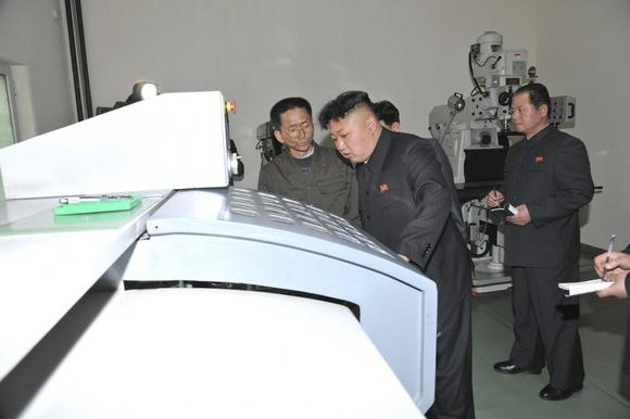 North Korean leader Kim Jong Un (C) provides field guidance during a visit to a machine plant managed by Kang Thae Ho in this undated photo released by North Korea's Korean Central News Agency (KCNA) in Pyongyang March 20, 2014. REUTERS/KCNA