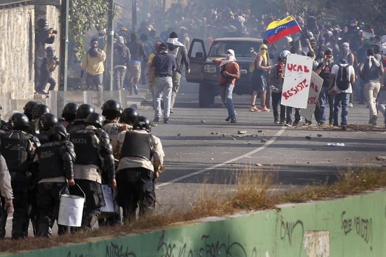 Venezuela says street protests have caused $10 billion...
