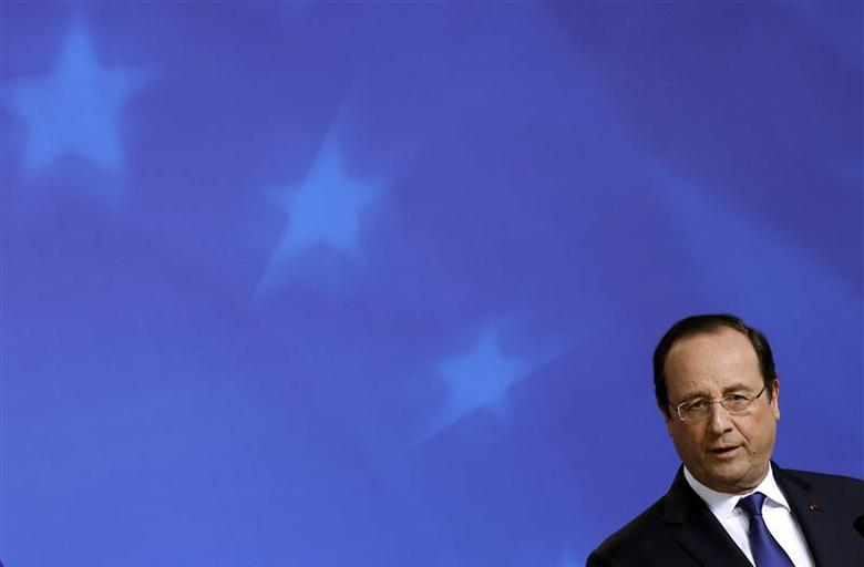 France's President Francois Hollande holds a news conference after a European Union leaders summit in Brussels March 21, 2014. REUTERS/Yves Herman