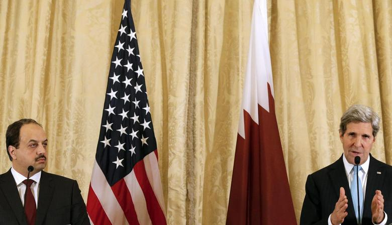U.S. Secretary of State John Kerry (R) and Qatar Foreign Minister Khaled Al-Attiyah attend a news conference after a meeting at the U.S. embassy alongside a gathering of the Friends of Syria, in Paris, January 12, 2014. REUTERS/Christian Hartmann