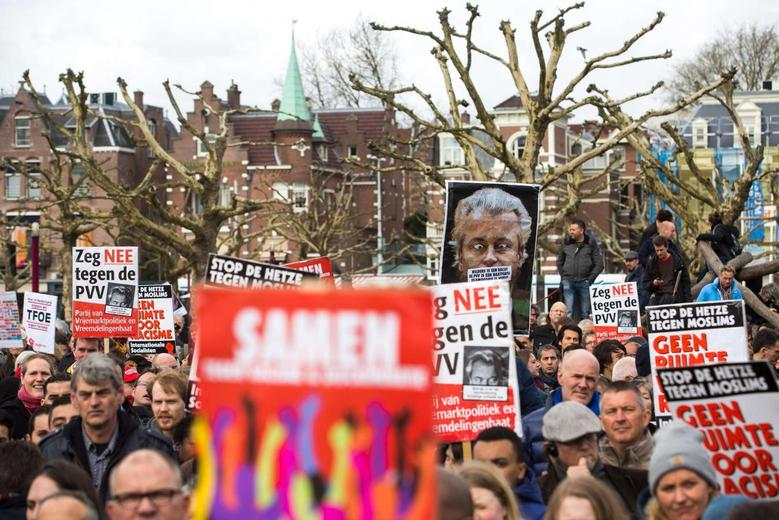 People take part in a protest against Geert Wilders, leader of the Dutch hard-right Freedom Party, in Amsterdam March 22, 2014. REUTERS/Cris Toala Olivares
