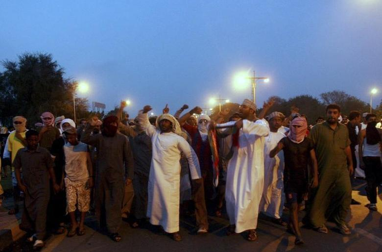 Omani protesters shout slogans during a demonstration in the northern industrial town of Sohar in Oman February 28, 2011. REUTERS/Jumana El-Heloueh