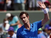 Mar 23, 2014; Miami, FL, USA; Andy Murray waves to the crowd after his match against Feliciano Lopez (not pictured) on day seven of the Sony Open at Crandon Tennis Center. Murray won 6-4, 6-1. Mandatory Credit: Geoff Burke-USA TODAY Sports