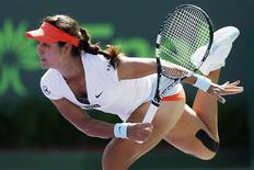 Mar 23, 2014; Miami, FL, USA; Li Na serves against Madison Keys (not pictured) on day seven of the Sony Open at Crandon Tennis Center. Mandatory Credit: Geoff Burke-USA TODAY Sports